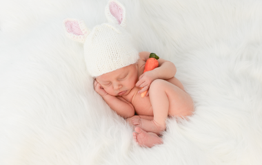 Newborn baby photograph with crocheted knit bunny hat