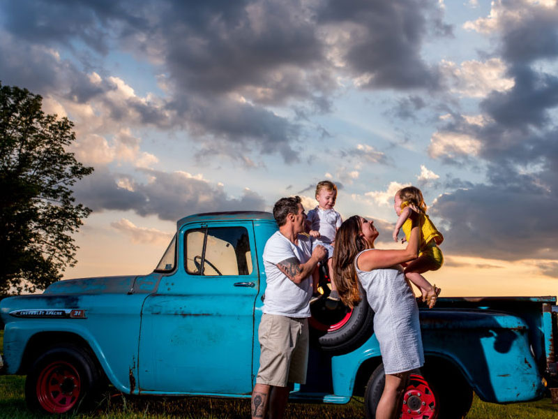 Family portrait with vintage farm truck by Southern Pennsylvania and Philadelphia family photographer Tara Lynn of Silver Orchid Photography