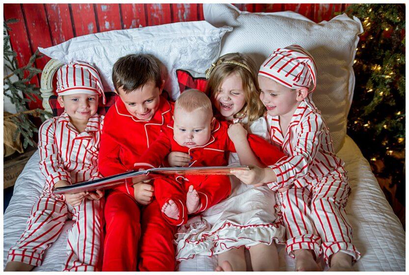kids reading in christmas pajamas